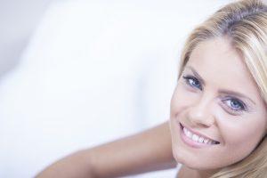blond woman having breakfast in bed